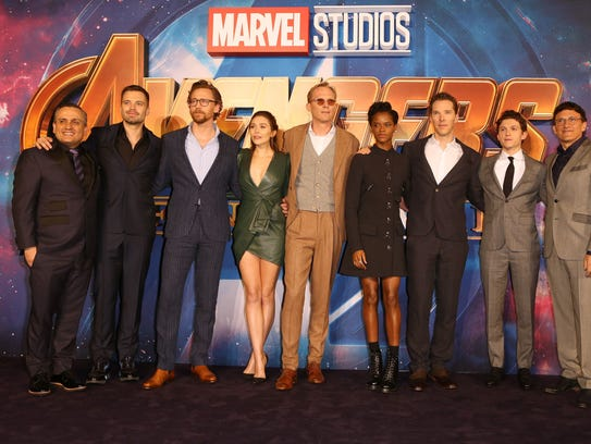 """University of Iowa alum and blockbuster movie director Joe Russo, far left, stands with cast members of """"Avengers: Infinity War"""" at the April 8, 2018, London fan event for the movie."""