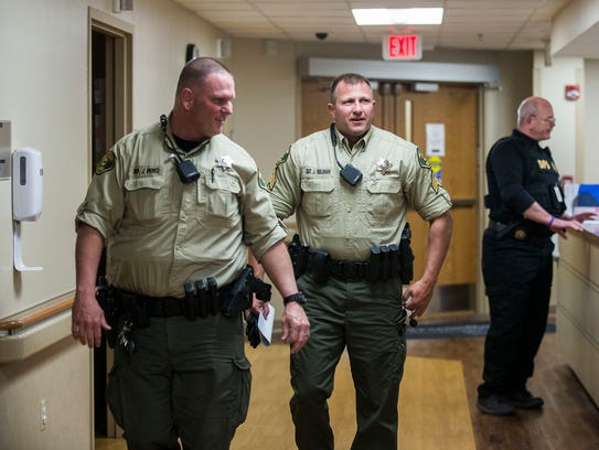Deputy John Parks, left, and Sgt. Jeff Rullman of the
