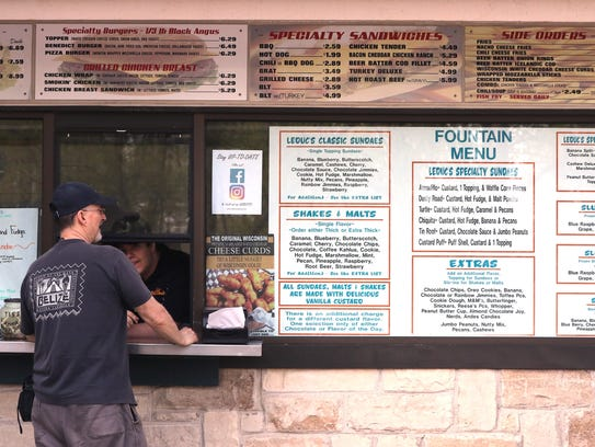 A customer places an order at the walk-up window at