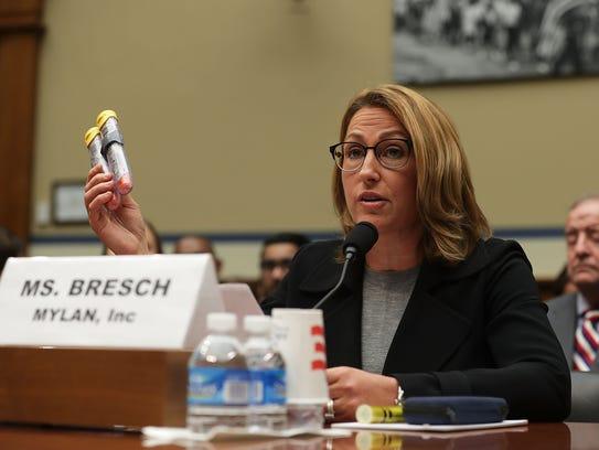 Mylan Inc. CEO Heather Bresch holds up a 2-pack of