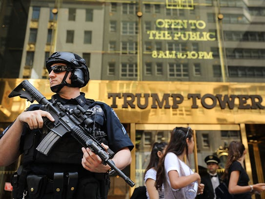 Police stand guard outside of Trump Tower on Aug. 4,
