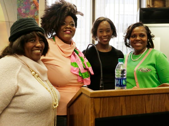 """""""Hidden Figures"""" author Margot Lee Shetterly, second from the right, takes a photo with fans at the Black Cultural Center on Wednesday, Jan. 25, 2017. Shetterly held a Q&A session there before her public speech at Purdue Wednesday night."""