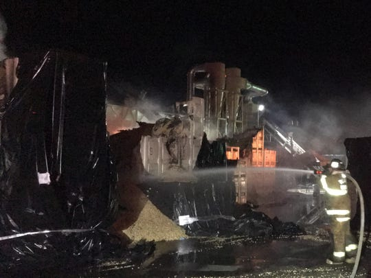 Tulare County firefighters worked to extinguish flames at Aro Pistachio.