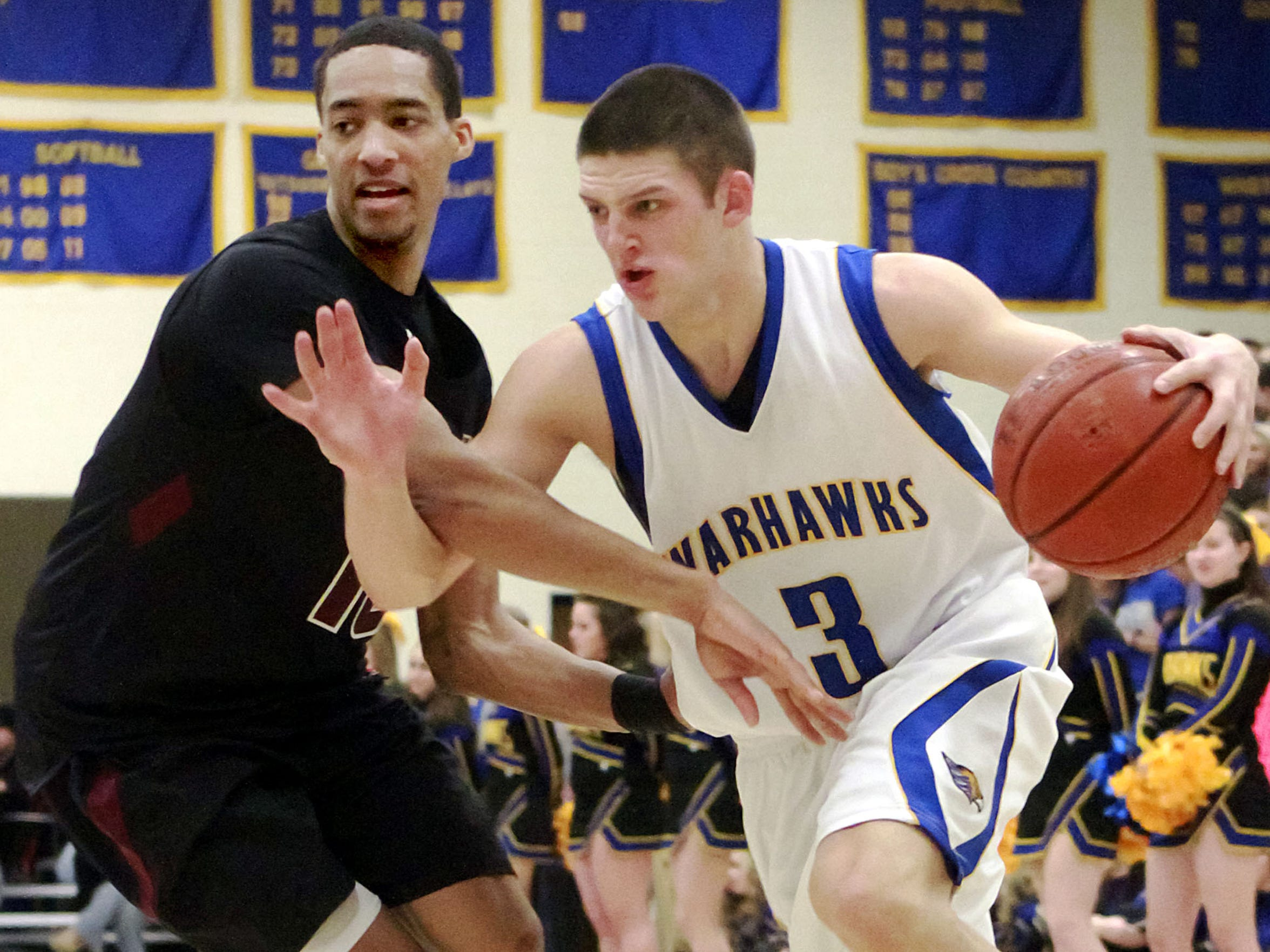 Germantown's Zak Showalter drives toward the basket