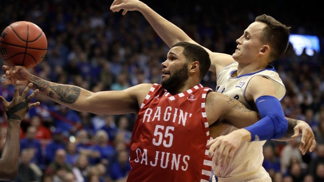 Louisiana Lafayette forward Justin Miller (55) is fouled by Kansas forward Mitch Lightfoot, right, during the first half of an NCAA college basketball game in Lawrence, Kan., Friday, Nov. 16, 2018. (AP Photo/Orlin Wagner)