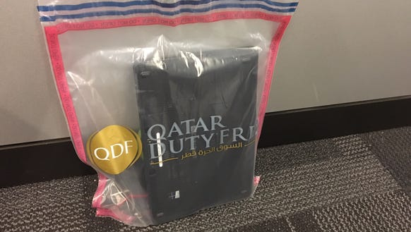 Qatar Airways swabs electronics in carry-on bags for