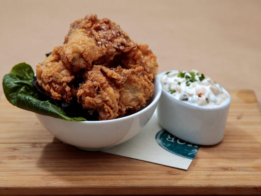 Fried oysters with tartar, pictured, Wednesday, Jan.