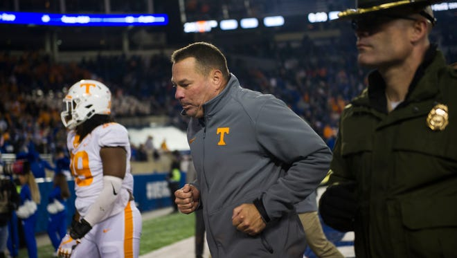 Tennessee Head Coach Butch Jones runs off the field after the Tennessee vs. Kentucky game at Kroger Field in Lexington, Kentucky Saturday, Oct. 28, 2017. Kentucky defeated Tennessee 29-26.