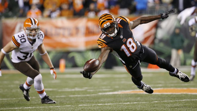 Cincinnati Bengals wide receiver A.J. Green (18) could not make the catch in the fourth quarer against the Cleveland Browns at Paul Brown Stadium.