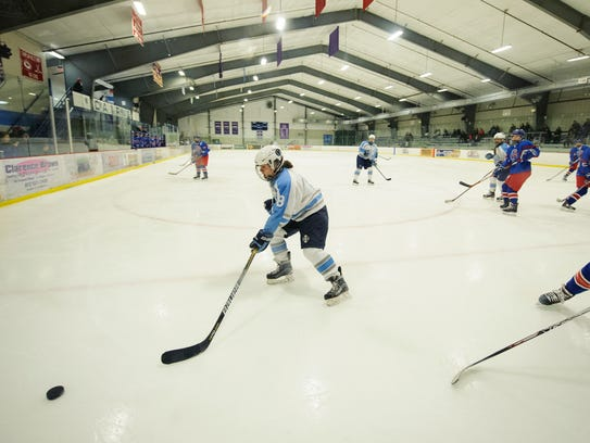 South Burlington's Claire Wright (8) plays the puck