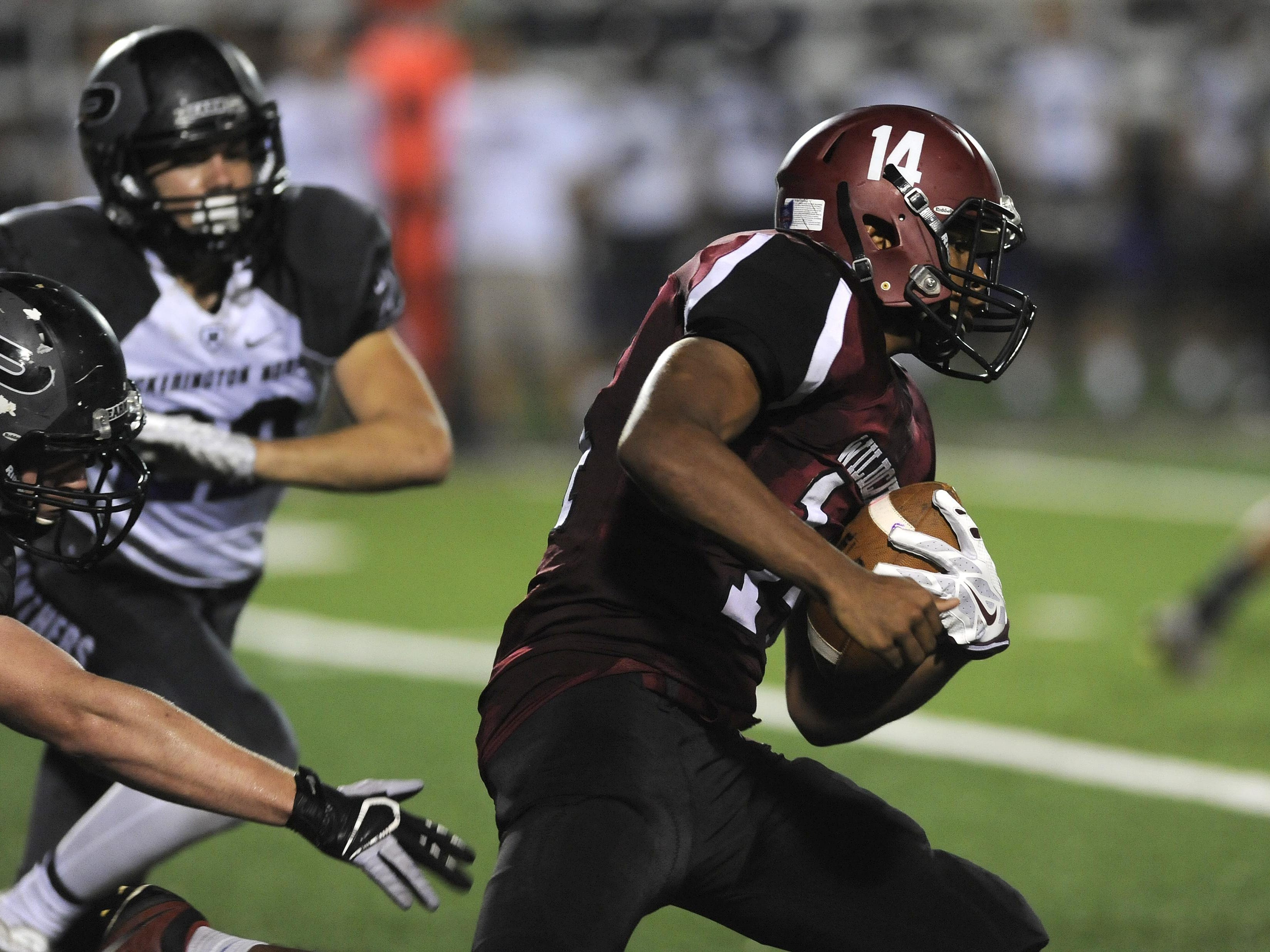 Newark running back D'ante Woods carries the ball during this past Friday's game against Pickerington North.