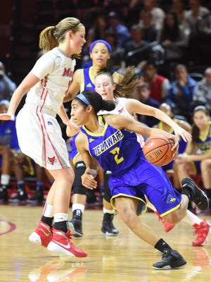 Delaware's Courtni Green drives past Marist's Kendall Baab during Thursday's game at Marist College in Poughkeepsie, New York.