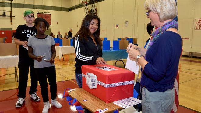 """Alma Zurita, center, turns in her ballot during the California Student Mock Presidential Election at Balboa Middle School on Tuesday. """"In the last two presidential elections, our students here at Balboa accurately predicted the next president of the United States,"""" said Renee Young, a world geography and U.S. history teacher at the school."""