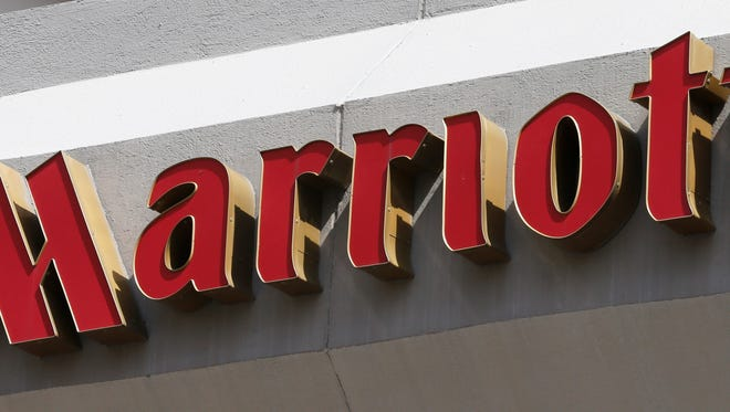 FILE - This Wednesday, March 23, 2016, file photo, shows a sign at a Marriott Hotel in Richmond, Va. Marriott International plans to remove plastic straws and drink stirrers from all of its 6,500 hotels and resorts worldwide by 2019. (AP Photo/Steve Helber, File)