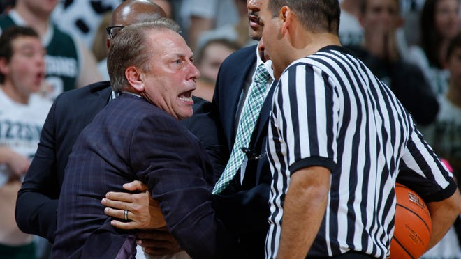 Michigan State coach Tom Izzo is held back by assistant coach Mike Garland, left rear, and director of basketball operations David Thomas, center, as he argues a call with official Bo Boroski, right, during the first half of an NCAA college basketball game against Florida Gulf Coast, Sunday, Nov. 20, 2016, in East Lansing, Mich. (AP Photo/Al Goldis) ORG XMIT: ELJ105