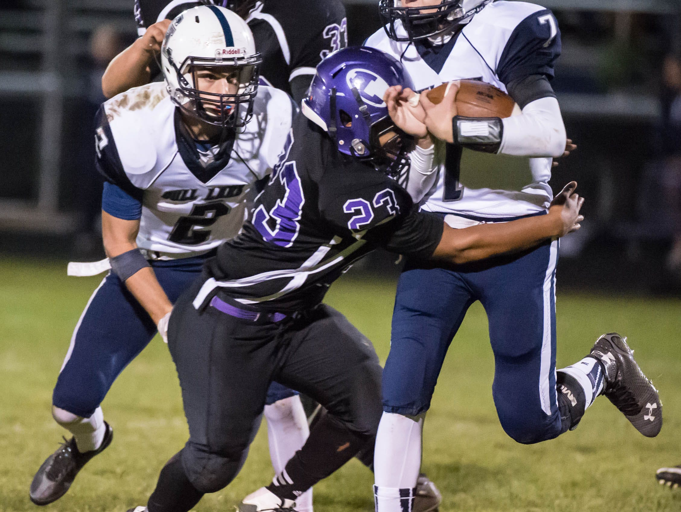 Lakeview's CJ Foster (23) tackles Gull Lakes's Hunter Snyder (7).