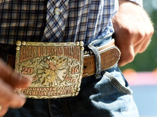 Like most bull riders Cody Nance loves big belt buckles.