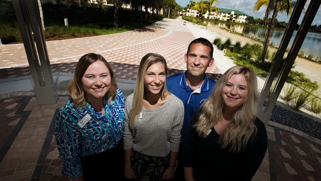 Brian Fisher, director of housing at FGCU, center right, with members of his staff fron left, Danielle Galipeau, Kristy Peterson and Taelor Rimer. Galipeau is a graduate and Peterson is a student at FGCU. With compettion from off campus housing, Fisher and his crew are overseeing programs to keep students housed on campus which includes building a new boardwalk (background) and an eatery.