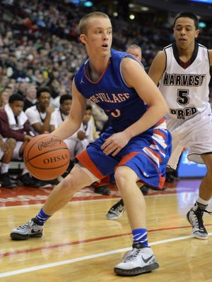 Tri-Village's Tyler VanWinkle moves the ball gainst Harvest Prep's Jordan Clark during the Division IV State basketball game, Saturday, March 28, 2015, at Ohio State in Columbus, Ohio.