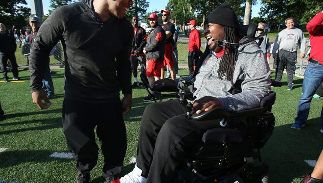 Former Rutgers players Ray Rice and Eric LeGrand share a laugh during the Rutgers Football Tri-state Showcase held on the campus of Fairleigh Dickinson University for high school recruits. Rutgers head football coach Chris Ash was joined by Ohio State head coach Urban Meyer and Temple head coach Matt Rhule. June 8, 2016, Florham Park, NJ
