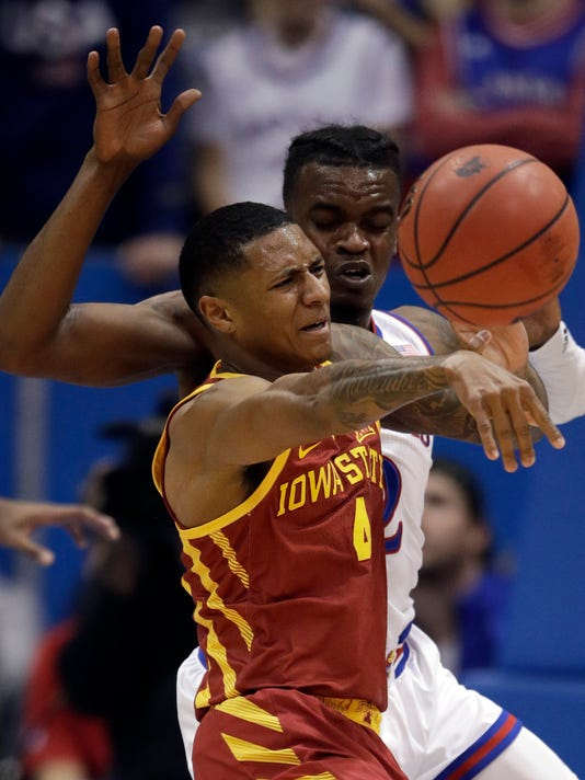 Iowa State guard Donovan Jackson (4) passes to a teammate as Kansas guard Lagerald Vick, back, defends during the first half of an NCAA college basketball game in Lawrence, Kan., Tuesday, Jan. 9, 2018. (AP Photo/Orlin Wagner)
