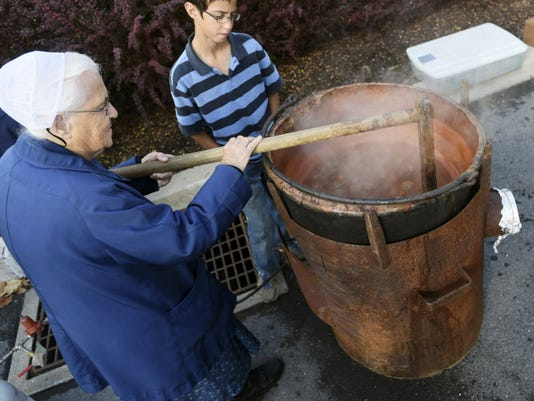 Apple butter is made at AppleFest in Chambersburg on Saturday, October 18, 2014.