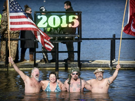 Robert Myer Jr., Betty Montgomery, Rob Rogan and John Santangelo pose in  the frigid water during the Cold for a Cause annual Polar Bear dip Thursday at Willow Springs Park in Richland on New Years Day. The event raises money for Developmental and Disability Services of the Lebanon Valley.