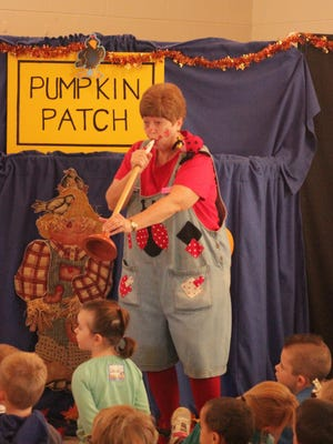 Grace Methodist Church volunteer Jan Richardson entertained local elementary and preschool kids with a puppet show Thursday morning at the Grace United Methodist Church. The kids visited the church's pumpkin patch and were treated to a show and story time by church volunteers.