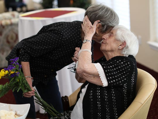 Linda Rou, left and Vivian Allen share an embrace on