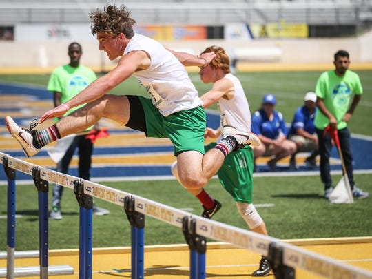 Blackwell's Hunter Clark jumps over the hurdle during the Region II-1A Track Meet Saturday, April 28, 2018, at Angelo State.