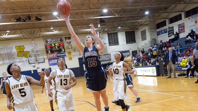 Allyson Howard shoots for two as Carencro takes on STM in girls basketball. Tuesday, Feb. 7, 2017.