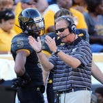 Southern Miss head coach Todd Monken talks things over with receiver D.J. Thompson during Saturday's win over Austin Peay.
