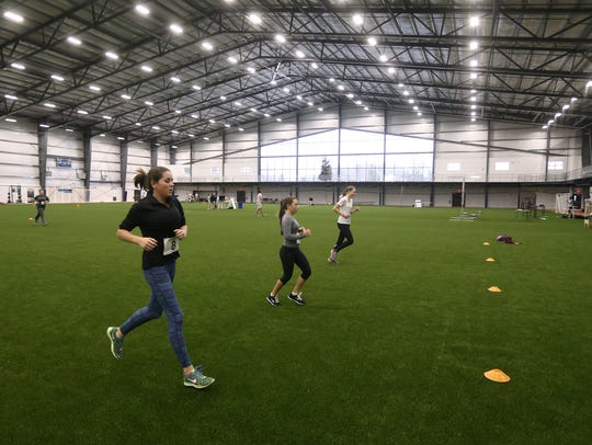 Athletes work out at the Pinnacle Athletic Campus in