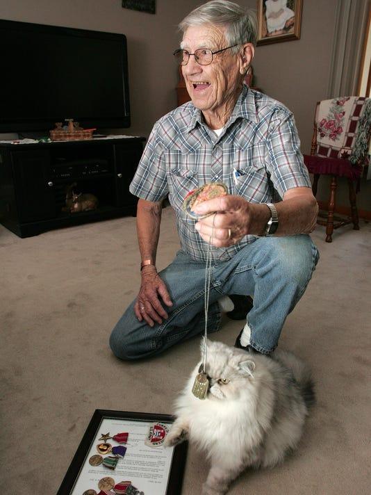 World War II veteran, Irwin Gibson, 90, of Coshocton.