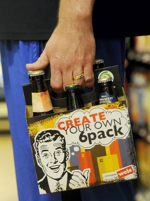Customers have the option to mix and match into a six pack at the Beer Cafe in a Weis Markets in York County.