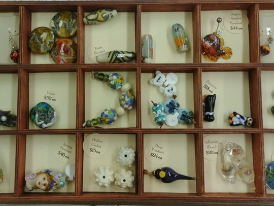 Shannon Vickers  makes and sells intricate glass beads.