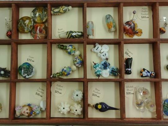Shannon Vickers  makes and sells intricate glass beads. She teaches a class at the Cape Coral Arts Studio.
