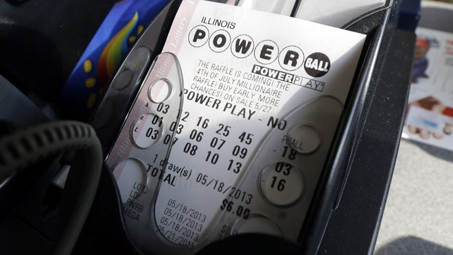 A Powerball lottery ticket is printed out of a lottery machine at a convenience store in Chicago.