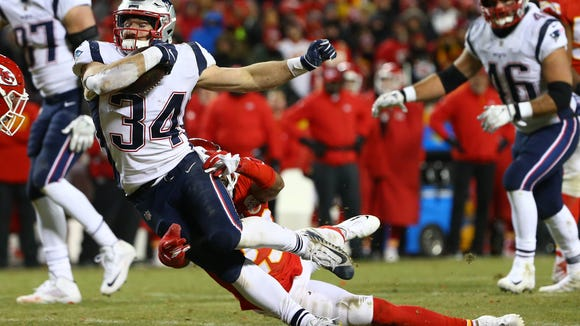 Jan 20, 2019; Kansas City, MO, USA; New England Patriots running back Rex Burkhead (34) runs the ball during overtime in the AFC Championship game against the Kansas City Chiefs at Arrowhead Stadium. Mandatory Credit: Jay Biggerstaff-USA TODAY Sports