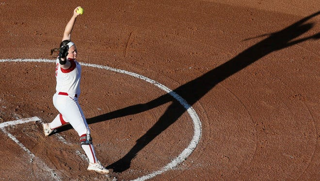 Oklahoma's Paige Parker casts a shadow as she pitches against Auburn in the second inning of the first game of the best of three  championship series during an NCAA college softball game in the NCAA Women's College World Series in Oklahoma City, Monday, June 6, 2016. (AP Photo/Sue Ogrocki)
