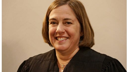 U.S. District Court Judge Mary S. McElroy.