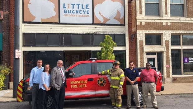 Hamilton Insurance Group Inc. of Mansfield, at left, and members of the Mansfield Fire Department, Tuesday gathered to make the announcement.