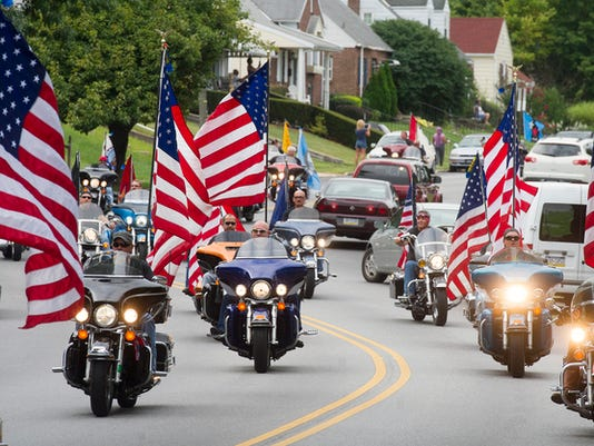 The God Bless America Motorcycle Color Guard leads the Labor Day Parade though York in 2014.