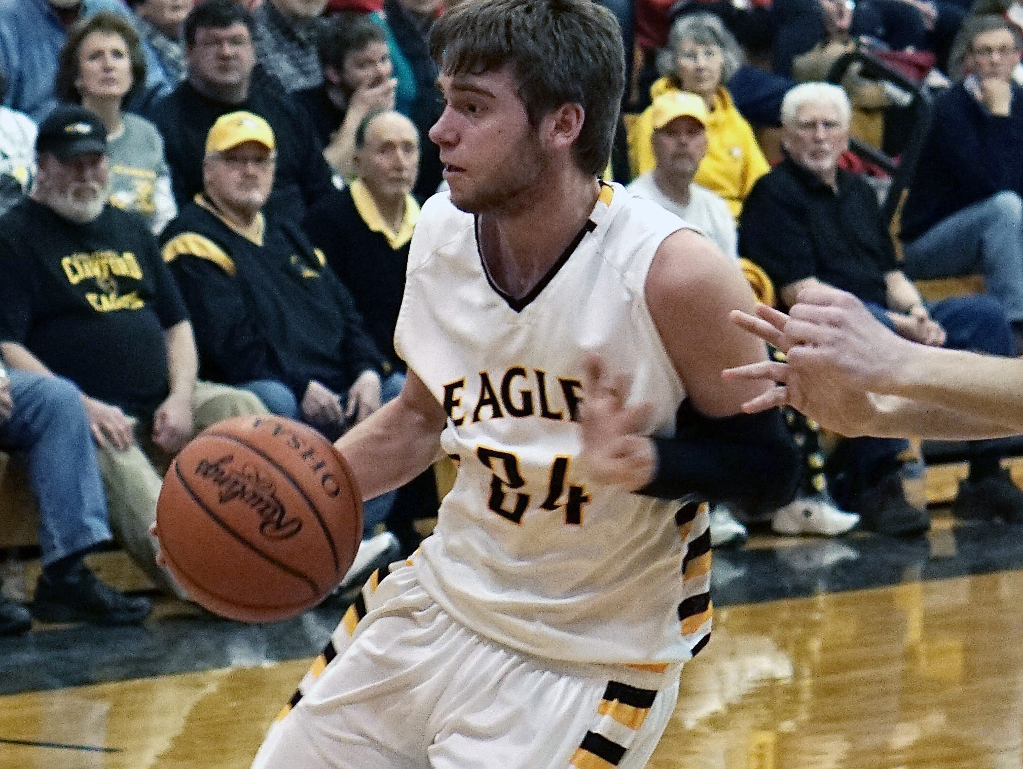Colonel Crawford's Todd Entenmann drives against Buckeye Central on Monday night. The Eagles clinched the Northern 10 Athletic Conference title outright with the win.