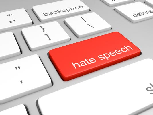 Hate speech key on computer keyboard representing online defamatory comments