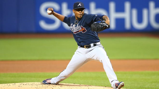 Atlanta Braves starting pitcher Julio Teheran (49) pitches against the New York Mets during the first inning at Citi Field.