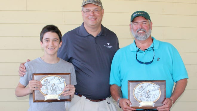 Highest scoring team was Team Waterfront Properties, which included Tom Pledger, Trace Scuderi, Rob Thompson and Taylor Thompson. Pictured are, from left, Scuderi, Treasure Health Vice President of Philanthropy Murray Fournie, and Pledger. Pledger also was first place individual shooter.