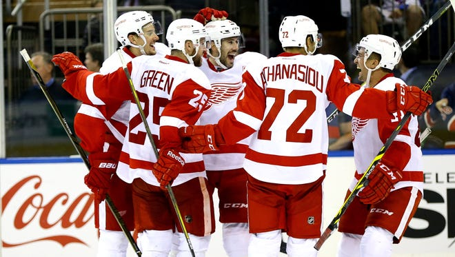 The Detroit Red Wings celebrate the game-winning goal by Drew Miller Wednesday at MSG.