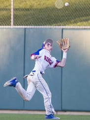 FILE – Nick Schnell tracks down an out in the outfield,