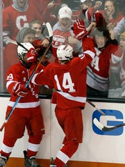 Canandaigua's Carter McWilliams (14) celebrates his goal, the last of the game, in a 5-3 win over Brockport in the Section V Class B semifinals last year.